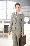 Attractive businesswoman arriving to bright office Stock Photo
