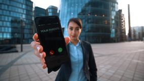 Attractive businesswoman ask You to answer call from parents. stock footage