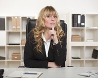 Attractive businesswoman asking for silence Stock Image
