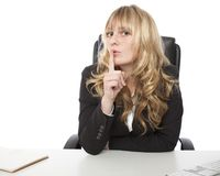 Attractive businesswoman asking for silence Stock Images