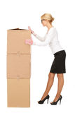 Attractive businesswoman with big boxes Royalty Free Stock Image