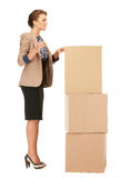 Attractive businesswoman with big boxes Stock Images