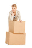 Attractive businesswoman with big boxes Royalty Free Stock Photo