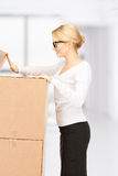 Attractive businesswoman with big boxes Stock Photos