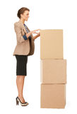 Attractive businesswoman with big boxes Stock Photography