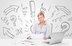 Attractive businesswoman brainstorming with drawn arrows and sym Royalty Free Stock Image