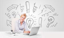 Attractive businesswoman brainstorming with drawn arrows and sym Royalty Free Stock Photo