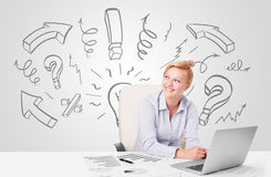 Attractive businesswoman brainstorming with drawn arrows and sym Stock Photography
