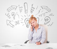 Attractive businesswoman brainstorming with drawn arrows and sym Stock Image