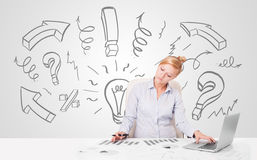 Attractive businesswoman brainstorming with drawn arrows and sym Royalty Free Stock Photography