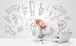Attractive businesswoman brainstorming with drawn arrows and sym Royalty Free Stock Photos