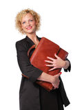 Attractive businesswoman with briefcase Royalty Free Stock Photography