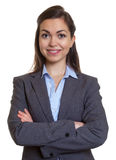 Attractive businesswoman with brown hair and crossed arms Stock Photography