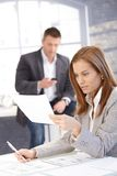 Attractive businesswoman busy by working Stock Images