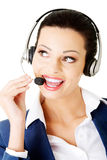 Attractive businesswoman on call centre. Stock Image