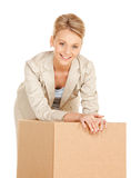 Attractive businesswoman with cardboard box Stock Images