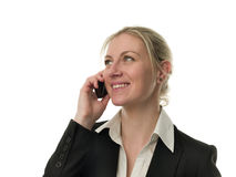 Attractive businesswoman with a cell phone Royalty Free Stock Photos