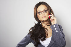 Attractive businesswoman with cell phone Royalty Free Stock Photos
