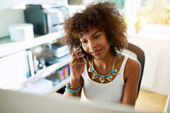 Attractive businesswoman chatting on a mobile Stock Image