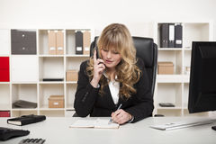 Attractive businesswoman chatting on the phone Stock Image