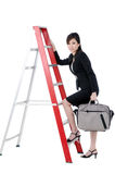 Attractive businesswoman climbing up ladder Stock Photos