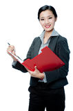 An attractive businesswoman with clipboard Royalty Free Stock Photos