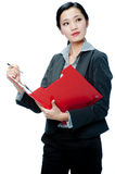 An attractive businesswoman with clipboard Stock Images