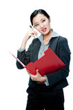 An attractive businesswoman with clipboard Royalty Free Stock Photography