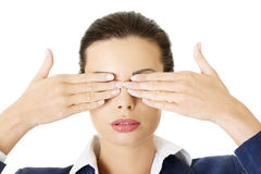 Attractive businesswoman covering her eyes Stock Image