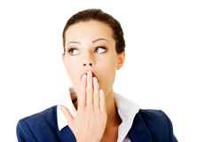 Attractive businesswoman covers her mouth. Isolated on white Stock Photo