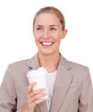 Attractive businesswoman drinking a coffee Royalty Free Stock Photography