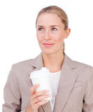 Attractive businesswoman drinking a coffee Royalty Free Stock Photos