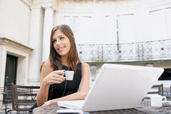 Businesswoman drinking coffee with laptop Royalty Free Stock Photo