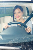 Attractive businesswoman drive luxury car smiling Royalty Free Stock Image