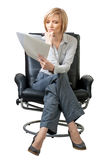 Attractive businesswoman examining documents Stock Photography