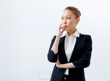 Attractive businesswoman in formal suit stock photos