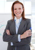 Attractive businesswoman in front of a white board Stock Images