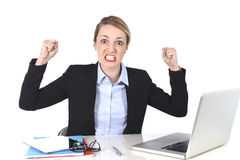 Attractive businesswoman frustrated expression at office working Stock Photos