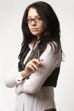Attractive businesswoman in glasses with pen Royalty Free Stock Photo