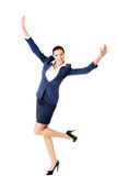 Attractive businesswoman with hands up. Cheerful. Stock Photography