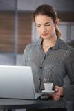 Attractive businesswoman having coffee-break Stock Images