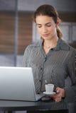 Attractive businesswoman having coffee-break Stock Images