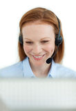 Attractive businesswoman with headset on Royalty Free Stock Images