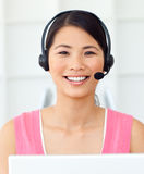 Attractive Businesswoman with headset on. At work Stock Photos