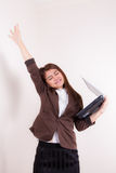 Attractive Businesswoman With Her Arms in The Air for Success. Photo of a young attractive and confident businesswoman, smiling with her arms in the air for Stock Photos