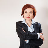 Attractive businesswoman with her arms crossed Royalty Free Stock Photos