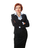 Attractive businesswoman with her arms crossed Stock Photo