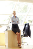 Attractive businesswoman with her arms crossed Royalty Free Stock Photo
