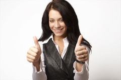 Attractive businesswoman with her thumbs raised up Stock Photos