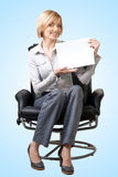 Attractive businesswoman holding a blank signboard Stock Photo